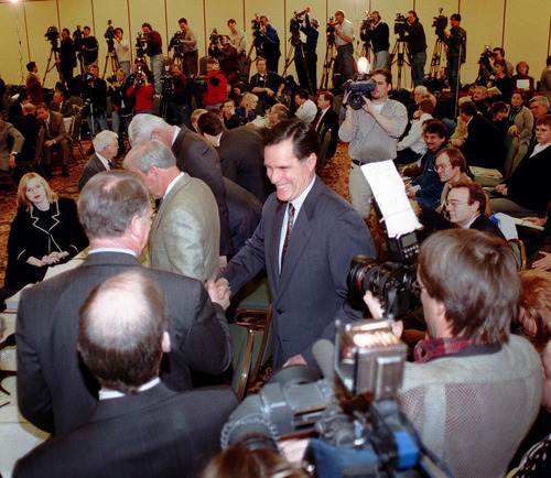 Steve Griffin  |  Tribune file photo As journalists from around the world recorded the moment on Feb. 10, 1999, Mitt Romney shook hands with Salt Lake Organizing Committee trustees following his introduction as SLOC's new president.