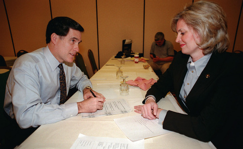 Steve Griffin  |  Tribune file photo In a side room at the Hilton Hotel, Mitt Romney conferred with his wife, Ann, while writing his acceptance speech just before being named president of the Salt Lake Organizing Committee in February 1999.