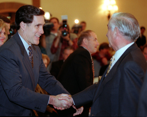Steve Griffin  |  Tribune file photo A meeting of the presidents: Mitt Romney shakes hands with his predecessor, Frank Joklik, at the Salt Lake Organizing Committee board session in which Romney became SLOC's boss.