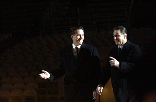 Salt Lake Organizing Committee President Mitt Romney, left, shares a light moment with International Olympic Committee President Jacques Rogge at the beginning of the Opening Ceremony of the 2002 Winter Olympics.