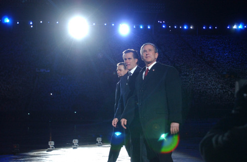 President George W. Bush joined SLOC President Mitt Romney and IOC President Jacques Rogge in the spotlight at the Feb. 8, 2002, Opening Ceremony of Salt Lake City's Winter Olympics.