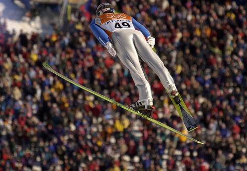 Trent Nelson | Tribune file photo American ski jumper Alan Alborn leaps out over the massive crowd at the Utah Olympic Park during qualifying in the large-hill competition.