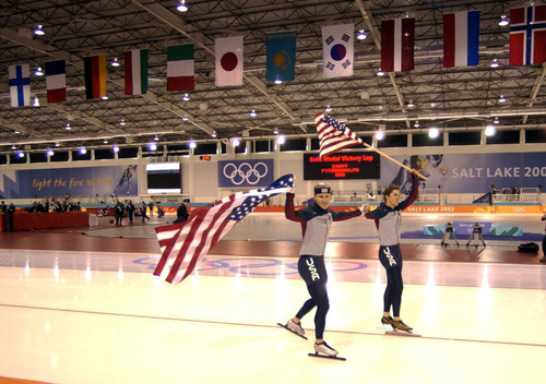 Steve Griffin | Tribune file photo Speedskaters Casey Fitzrandolph and Kip Carpenter of the United States wave flags while skating a victory lap following the men's 500 meters at the Utah Olympic Oval. Fitzrandolph won gold, while Carpenter took bronze.