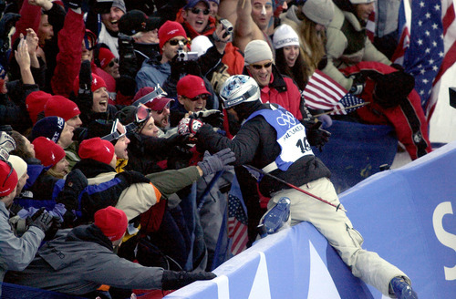 Paul Fraughton | Tribune file photo American Jonny Moseley jumps into the crowd to celebrate after his first run in the men's freestyle moguls competition at Deer Valley Resort.