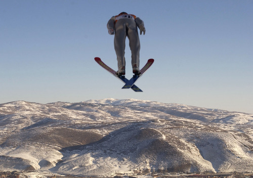 Trent Nelson | Tribune file photo Ski jumper Sylvain Freiholz of Switzerland soars off the jump in the large-hill competition at the Utah Olympic Park, with a stunning view of the surrounding landscape.