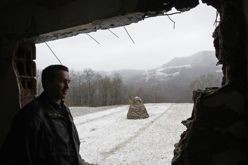 Amel Emric   Special to the Tribune Suljo Talovic, father of Sulejman Talovic,  looks out from a hole in his former house near the  villages of Talovici and Cerska. The house was destroyed  during the 1992-95 Bosnian war. Talovic now lives in Kalesija, a small town about 38 miles away.