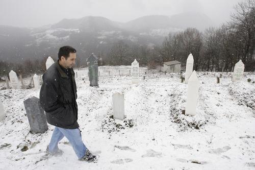 Amel Emric   Special to the Tribune Suljo Talovic, father of Sulejman Talovic, walks through the cemetery near the grave of his son.
