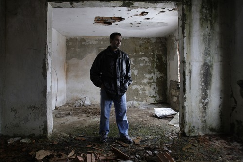 Amel Emric   Special to the Tribune Suljo Talovic, father of Sulejman Talovic,  looks at his living room inside his  house destroyed during the Bosnian war.