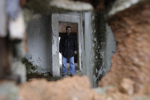 Amel Emric   Special to the Tribune Suljo Talovic, father of Sulejman Talovic, looks at his living room, seen through a shell hole. Talovic's house was destroyed during the 1992-95 Bosnian war,