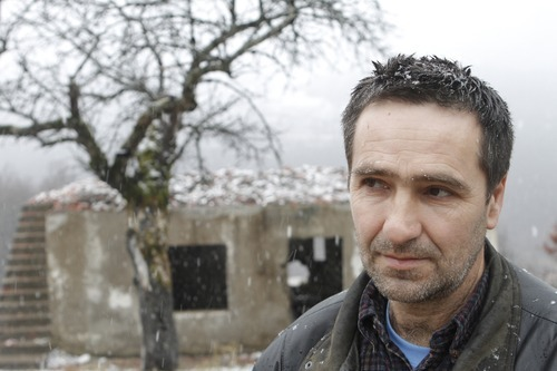 Amel Emric   Special to the Tribune Suljo Talovic, father of Sulejman Talovic, stands near a relative's house that was destroyed during the 1992-95 Bosnian war.