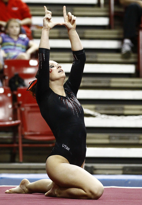 Photo by Rob Schumacher Utah's Stephanie McAllister performs on the floor during Sunday's meet against PAC-12 foe Arizona State at Wells-Fargo Arena in Tempe.