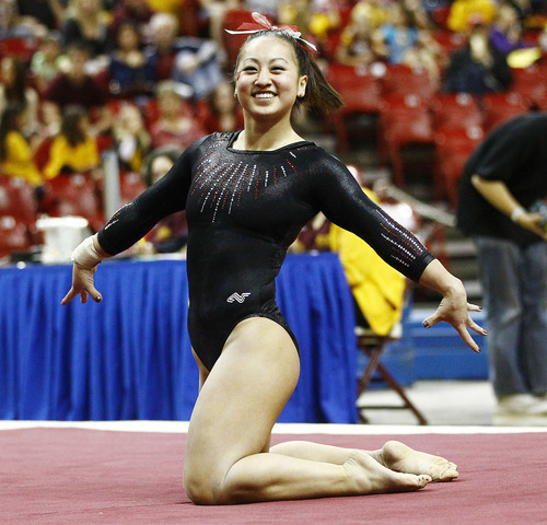 Photo by Rob Schumacher Utah's Corrie Lothrop performs on the floor during Sunday's meet against PAC-12 foe Arizona State at Wells-Fargo Arena in Tempe.