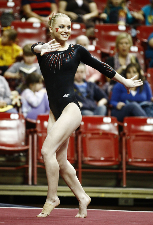 Photo by Rob Schumacher Utah's Georgia Dabritz performs on the floor during Sunday's meet against PAC-12 foe Arizona State at Wells-Fargo Arena in Tempe.