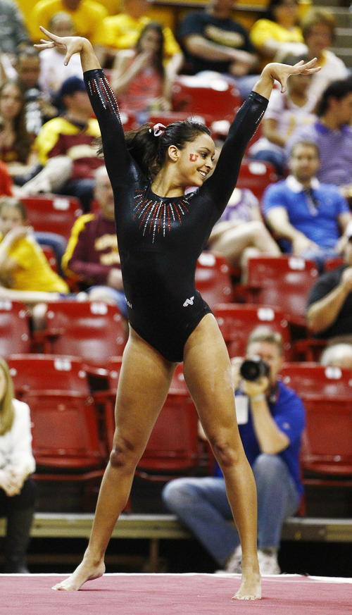Photo by Rob Schumacher Utah's Kailah Delaney performs on the floor during Sunday's meet against PAC-12 foe Arizona State at Wells-Fargo Arena in Tempe.