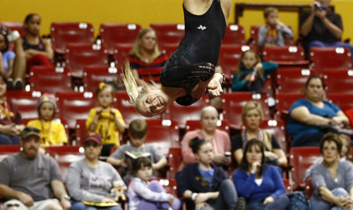Photo by Rob Schumacher Utah's Kyndal Robarts performs on the floor during Sunday's meet against PAC-12 foe Arizona State at Wells-Fargo Arena in Tempe.