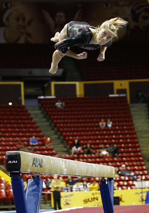 Photo by Rob Schumacher Utah's Mary Beth Lofgren dismounts from the beam during Sunday's meet against PAC-12 foe Arizona State at Wells-Fargo Arena in Tempe.