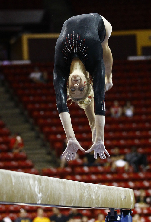 Photo by Rob Schumacher Utah's Mary Beth Lofgren performs on the beam during Sunday's meet against PAC-12 foe Arizona State at Wells-Fargo Arena in Tempe.