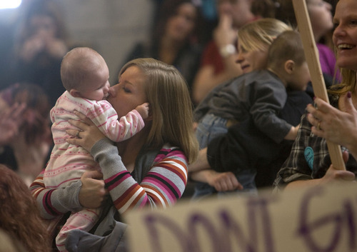 Al Hartmann  |  The Salt Lake Tribune Rachell Barnett kisses her 6-month-old baby Makayla in the crowd of nearly 400 people rallying to fight substance abuse.