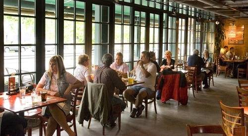 Tribune file photo Lunch diners at Red Rock Brewing Company, which is open until midnight on Friday and Saturday.