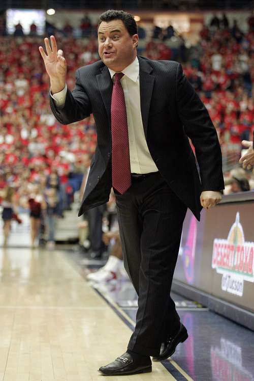 Arizona head coach Sean Miller signal in a play against Utah during the first half of an NCAA college basketball game at McKale Center in Tucson, Ariz., Saturday, Feb. 11, 2012. (AP Photo/Wily Low)