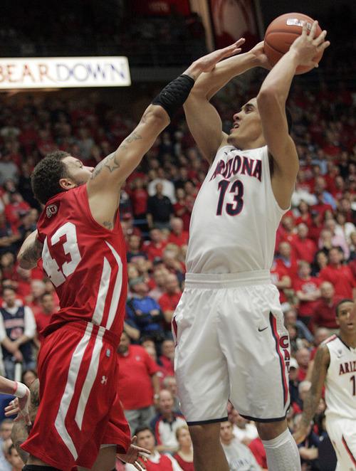 Arizona's Nick Johnson (13) shoots over Utah Cedric Martin (43) during the second half of an NCAA college basketball game at McKale Center in Tucson, Ariz., Saturday, Feb. 11, 2012.  Arizona won 70 - 61.(AP Photo/Wily Low)