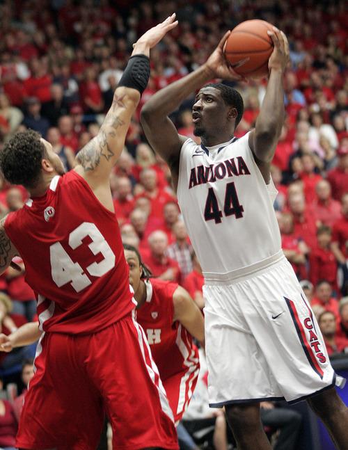 Arizona's Solomon Hill (44) shoots over Utah's Cedric Martin (43)during the second half of an NCAA college basketball game in Tucson, Ariz., Saturday, Feb. 11, 2012.  Arizona won 70 - 61.(AP Photo/Wily Low)