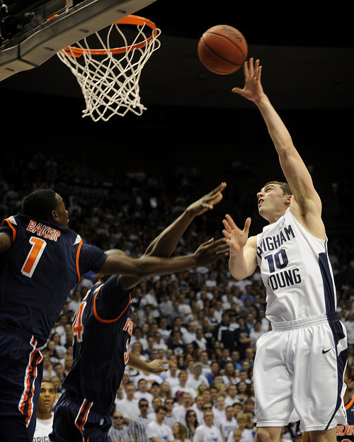 BYU's Matt Carlino (10) goes up for a basket during the first half of an NCAA college basketball game against Pepperdine at the Marriott Center in Provo, Utah, Saturday, Feb. 11, 2012. (AP Photo/The Daily Herald, James Roh)  MANDATORY CREDIT