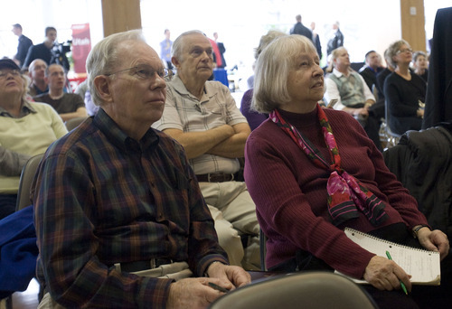 Al Hartmann  |  The Salt Lake Tribune  Ray and Mary Beckett listen to speakers and take notes at the Fraud College event at the University of Utah Wednesday February 15.  The event is to educate and inform the public in Utah against fraud with panels, speakers and booths.