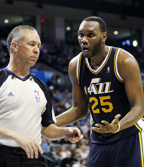 Utah Jazz center Al Jefferson (25) questions a call by official Jason Phillips, left, in the third quarter of an NBA basketball game in Oklahoma City, Tuesday, Feb. 14, 2012. Oklahoma City won 111-85. (AP Photo/Sue Ogrocki)