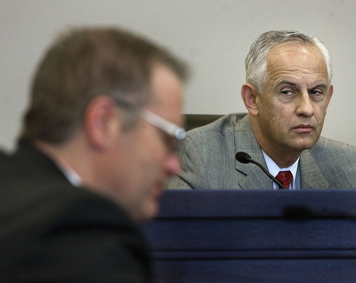 Scott Sommerdorf  |  The Salt Lake Tribune              Senate President Michael Waddoups, R-Taylorsville, listens as  Sen. Stephen Urquhart, R-St. George, left, urges passage of his plan to repeal Utah's guest-worker law. Waddoups later made a motion to table the bill -- essentially killing it. The motion passed.