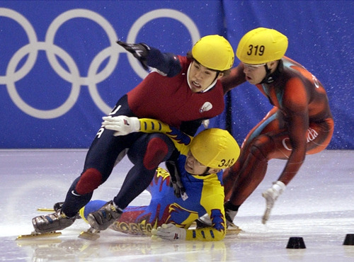Steve Griffin | Tribune file photo Korea's Hyun-soo Ahn crashes into American short-track speedskater Apolo Anton Ohno in the final turn of the men's 1,000 meters, taking Canada's Mathieu Turcotte with him and clearing the way for Australian Steven Bradbury to come from far behind and win gold at the Delta Center.