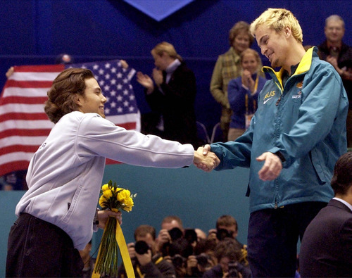 Leah Hogsten | Tribune file photo American Apolo Anton Ohno congratulates Australia's Steven Bradbury -- the man who made Ohno's skating boots in his backyard shop -- for winning the men's 1,000 meters in short-track speedskating after Ohno and three others crashed on the final turn at the Delta Center.