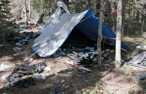 Courtesy Iron County Sheriff's Office Undated photo provided by the Iron County Sheriff's Office shows a remote camp littered with supplies and trash in the wilderness near Zion National Park. Authorities believe the camp was left behind by a suspect in more than two dozen burglaries of mountain cabins over an area of roughly 1,000 square miles for the past five years.