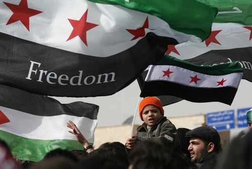 Syrians chant anti-Bashar al-Assad slogans during a protest in front of the Syrian embassy in Amman, Jordan, Friday, Feb. 17, 2012. (AP photo/Mohammad Hannon)