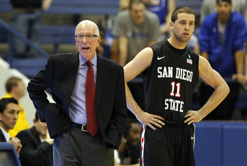 San Diego State head coach Steve Fisher, left, turns away after conferring with guard James Rahon in the first half of an NCAA basketball game against Air Force at Air Force Academy, Colo., on Saturday, Feb. 18, 2012. (AP Photo/David Zalubowski)