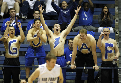 Air Force fans celebrate after a basket by guard Todd Fletcher, foreground, against San Diego State in the first half of an NCAA basketball game at Air Force Academy, Colo., on Saturday, Feb. 18, 2012. Air Force upset No. 13 San Diego State 58-56. (AP Photo/David Zalubowski)