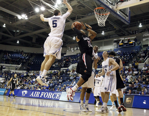 San Diego State forward Tim Shelton, second from left, goes up for a shot in heavy traffic as Air Force defenders, from left, Mike Fitzgerald, Kamryn Williams and Colt Barnhill cover in the first half of an NCAA basketball game at Air Force Academy, Colo., on Saturday, Feb. 18, 2012. (AP Photo/David Zalubowski)