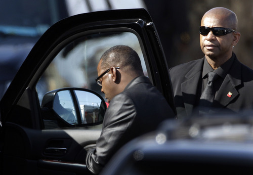 Singer Bobby Brown is escorted to a vehicle during the funeral of his ex-wife Whitney Houston at New Hope Baptist Church in Newark, N.J., Saturday, Feb. 18, 2012. Houston died last Saturday at the Beverly Hills Hilton in Beverly Hills, Calif., at the age 48. (AP Photo/Mel Evans)