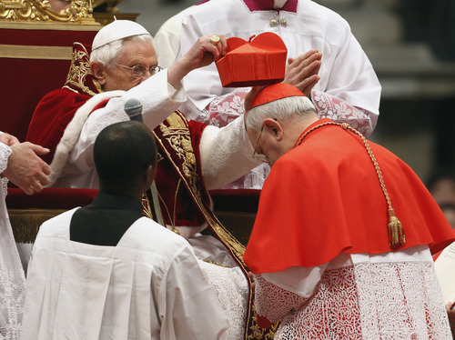 Newly-appointed cardinal Timothy Michael Dolan, of the United States, is elevated by Pope Benedict XVI in St. Peter's basilica at the Vatican, Saturday, Feb. 18, 2012. Pope Benedict XVI is bringing 22 new Catholic churchmen into the elite club of cardinals who will elect his successor amid signs the 84-year-old pontiff is slowing down. Benedict was presiding over a ceremony Saturday in St. Peter's Basilica to formally create the 22 cardinals, who include the archbishops of New York, Prague, Hong Kong and Toronto as well as the heads of several Vatican offices. (AP Photo/Andrew Medichini)