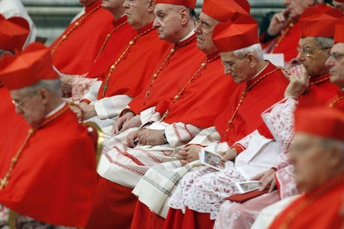 Cardinals sit during a consistory in St. Peter's basilica at the Vatican, Saturday, Feb. 18, 2012. Pope Benedict XVI is bringing 22 new Catholic churchmen into the elite club of cardinals who will elect his successor amid signs the 84-year-old pontiff is slowing down. Benedict was presiding over a ceremony Saturday in St. Peter's Basilica to formally create the 22 cardinals, who include the archbishops of New York, Prague, Hong Kong and Toronto as well as the heads of several Vatican offices. (AP Photo/Andrew Medichini)
