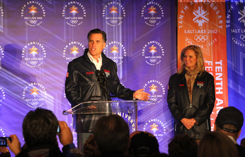 Rick Egan  | The Salt Lake Tribune   Mitt Romney motions to his wife Ann, as he speaks to a group of former SLOC members in the Grande Hall at the Gateway Center, Saturday, February 18, 2012.