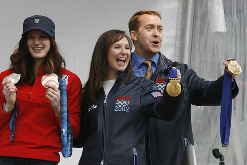 Scott Sommerdorf  |  The Salt Lake Tribune              Olympic medalists Katherine Reuter, Tristan Gale Geisler, and Jim Shea display their medals at the Sports Festival at The Gateway. The event was held to commemorate the 10th anniversary of the 2002 Winter Olympics, Saturday February 18, 2012.