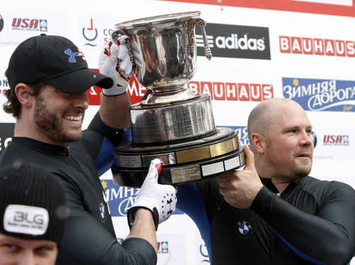 USA's pilot Steven Holcomb, right, and brakeman Steven Langton react after winning the men's two-man bobsled world championships in Lake Placid, N.Y., on Sunday, Feb. 19, 2012. (AP Photo/Mike Groll)