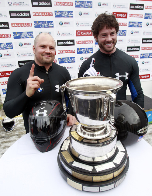 USA's pilot Steven Holcomb, left, and brakeman Steven Langton react after winning the men's two-man bobsled world championships in Lake Placid, N.Y., on Sunday, Feb. 19, 2012. (AP Photo/Mike Groll)