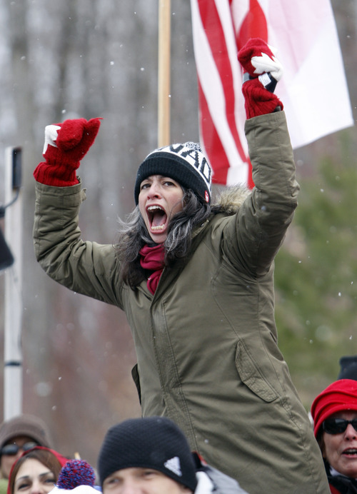 A fan cheers on Canada in the men's two-man bobsled world championships in Lake Placid, N.Y., on Sunday, Feb. 19, 2012. (AP Photo/Mike Groll)