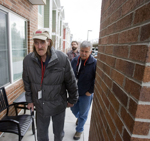 Al Hartmann  |  The Salt Lake Tribune Like Joseph Koch, Jeffrey Moss, left, was also cycling in and out of emergency rooms while living on the streets. Here, after getting help in a new health care experiment, Moss returns to his apartment with mobile medical team members Ed Snoddy and Joel Hunt, who had taken him to a methadone clinic. Pictured here,  the 55-year-old is six months housed and sober.