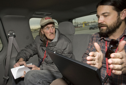 Al Hartmann  |  The Salt Lake Tribune Joel Hunt, a physician assistant for the Fourth Street Clinic, right, reviews Jeffrey Moss' medical records as they drive to Moss' methadone appointment. Moss skipped an appointment at the clinic, but Hunt, part of a mobile medical team, takes his medicine on the road.