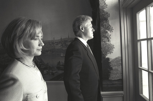 President Clinton and First Lady Hillary Rodham Clinton stand alone and look out a window before the President Kim State Arrival Ceremony. (June 9, 1998) Credit: Courtesy of William J. Clinton Presidential Library