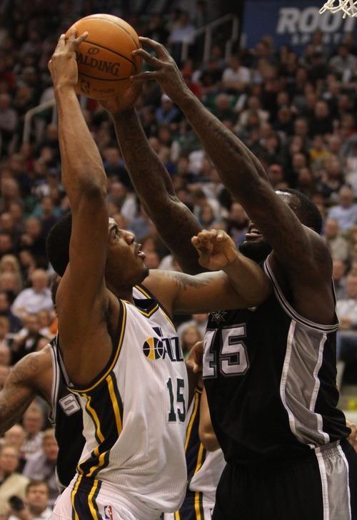 Rick Egan    The Salt Lake Tribune   San Antonio Spurs forward DeJuan Blair (45) blocks a shot by Utah Jazz power forward Derrick Favors (15) in NBA action in Salt Lake City, Monday, February 20, 2012.