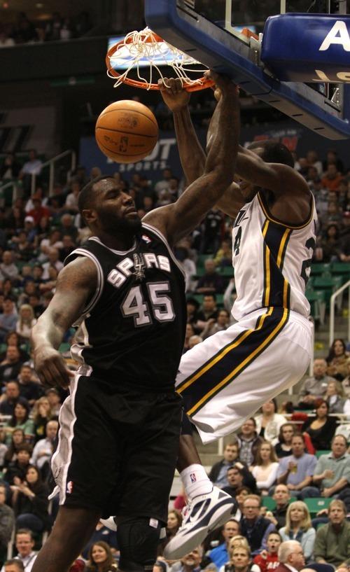 Rick Egan    The Salt Lake Tribune   Utah Jazz power forward Paul Millsap (24) dunks the ball over San Antonio Spurs forward DeJuan Blair (45) in NBA action in Salt Lake City, Monday, February 20, 2012.